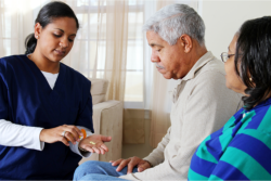 serving medicine to an elderly couple